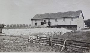 August 16, 1921 Threshing grain on Swartz Farm, west of Wernersville, PA along pike tenanted by James Luckenbill. Notice stone fence around barn courtyard, and post and rail fencing in foreground.